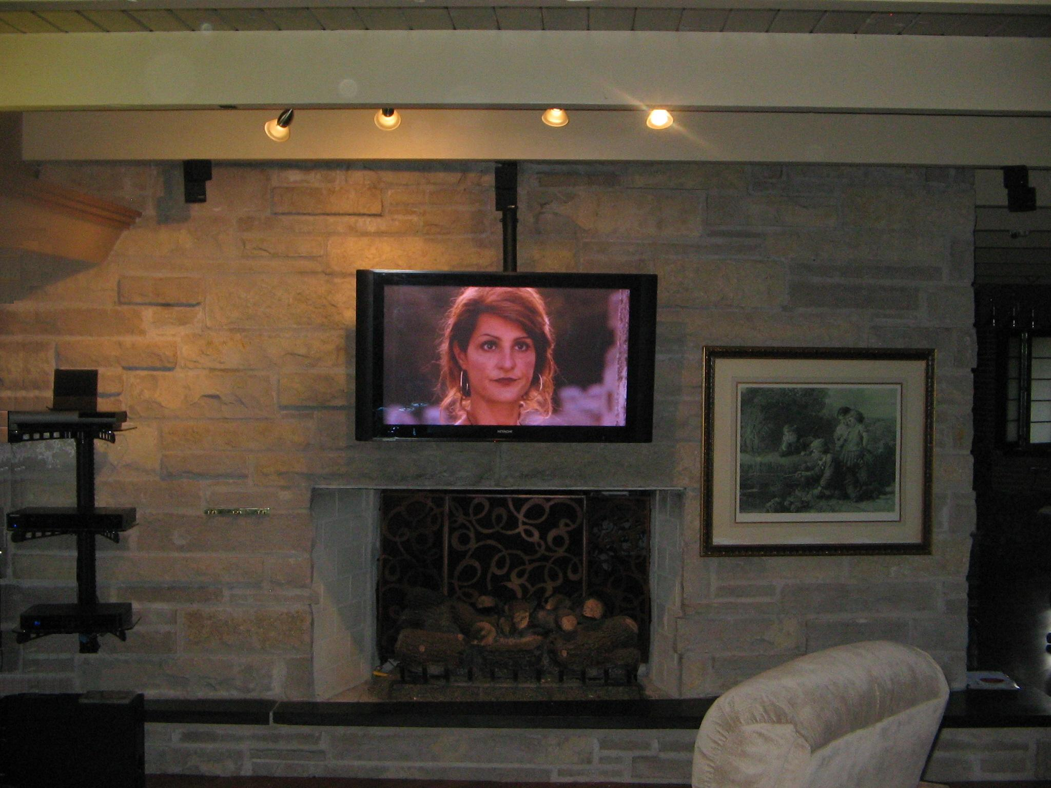 Plasma Hdtv Mounted In Front Of The Fireplace Css